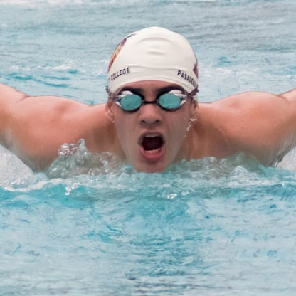 Ryan Caceres, of the PCC swim team, practices his butterfly stroke.