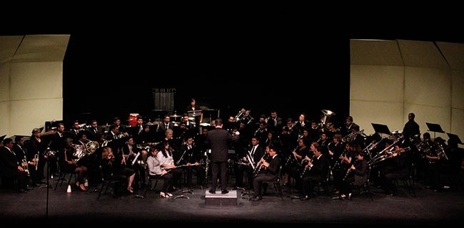 (Barney Soto/Courier) PCC Lancer Concert Band perform at the Sexson Auditorium, Friday, March 21, 2014. Their repertoire included works from promenint composers, such as, Duke Ellington and Johann Sebastian Bach.