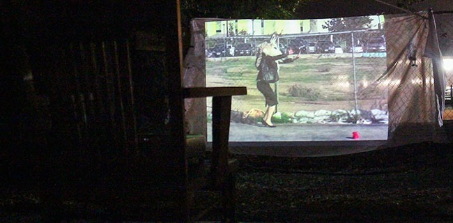 The short art film Odyssey by Zig Grown projected on an abandon house by the art group Sidestreet Projects during Artnight in Pasadena,Calif. on Friday, October 10,2014. (Daniel Nerio/Courier)