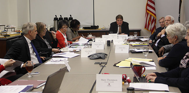 A search firm makes a presentation to the Board of Trustees at a meeting on Tuesday. (Paul Ochoa/Courier)