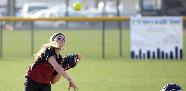 Freshman catcher Holly Riker-Sloan fouls off during her second at bat on Wednesday, February 4, 2015. Riker-Sloan would hit a solo home run the next pitch. (Max Zeronian/Courier)