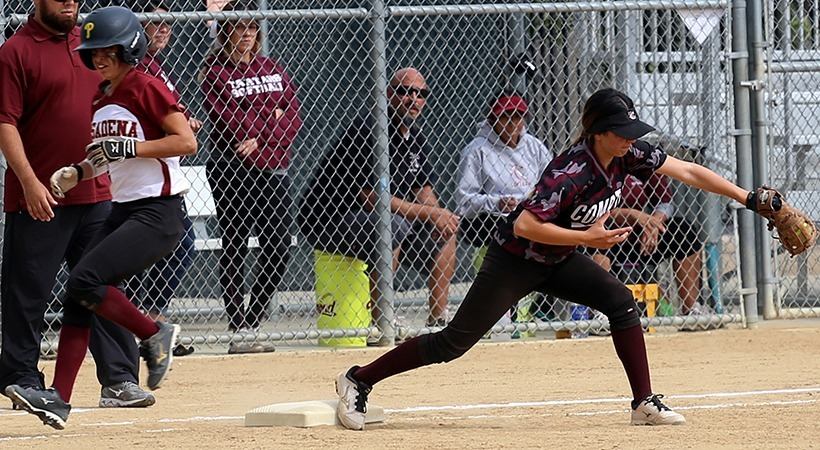 Shortstop Anais Sustayta throws to third baseman Alejandra Grimaldo for the third out of the seventh inning, April 21, 2015. The Lancers' defense held ECC Compton to two runs until the sixth inning. (Max Zeronian/Courier)
