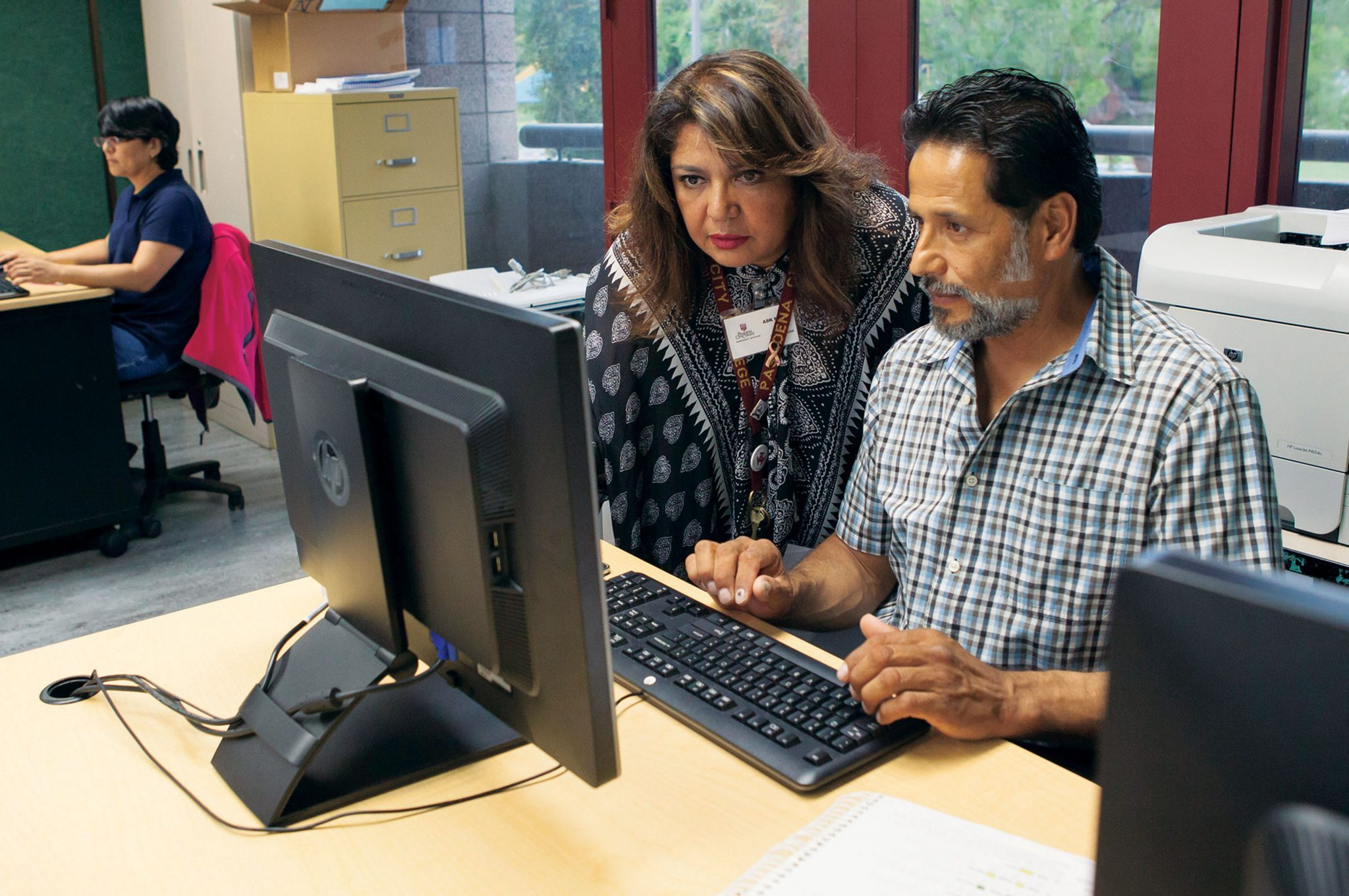 Katja Liebing/Courier Teresa Deukmedjian is helping student Rogelio Moreno of Pasadena in her bilingual Computer Keyboarding class in the Villa Parke Community Center on September 14, 2015. The class is one of many tuition free courses that is being offered at Pasadena City College's Noncredit Division, the Community Education Center.