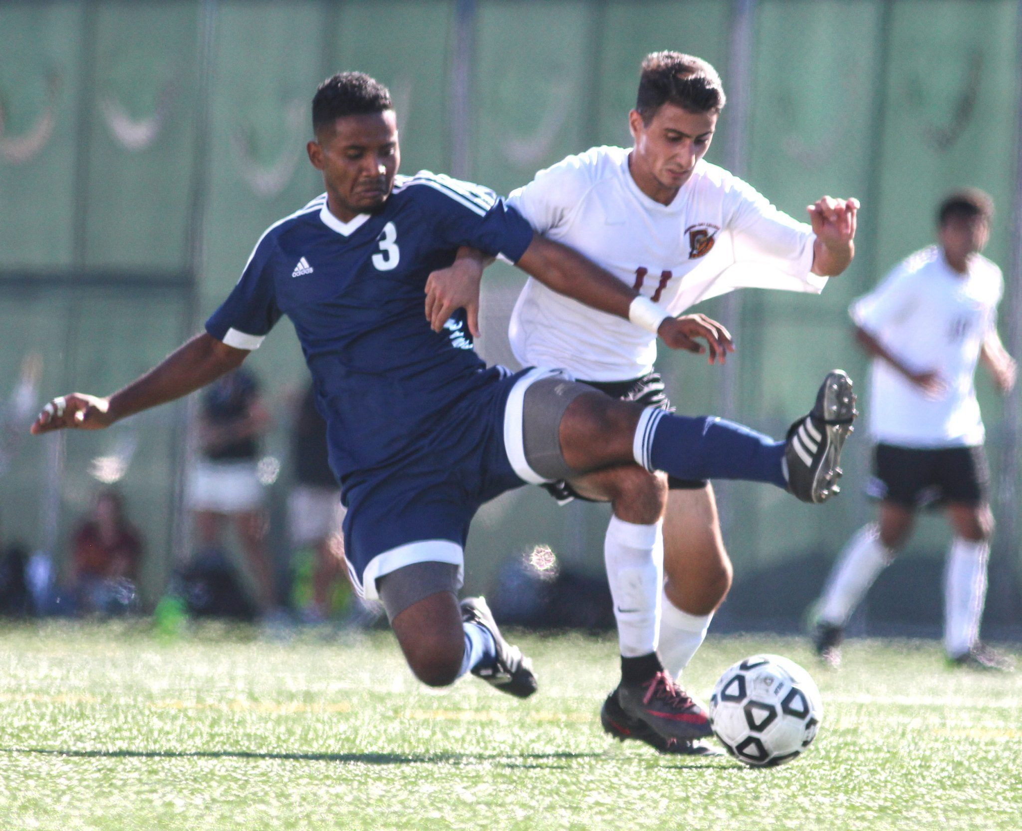 Samantha Molina/Courier Freshman forward Artin Almary defends the ball from the Warriors' defender Daniel Lumbrano at El Camino College on Friday, October 2, 2015. The Lancers tied with El Camino, 1-1.