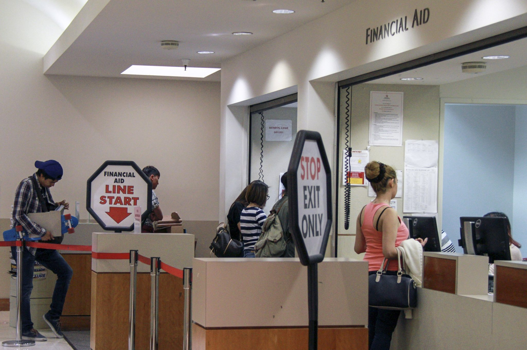 Kristen Luna/Courier Students line up to ask questions regarding their financial aid at the financial aid office at L114 on Wednesday, March 3. Many students have expressed their concerns and frustrations wtih the financial aid office and the lack of consistency regarding financial aid information.
