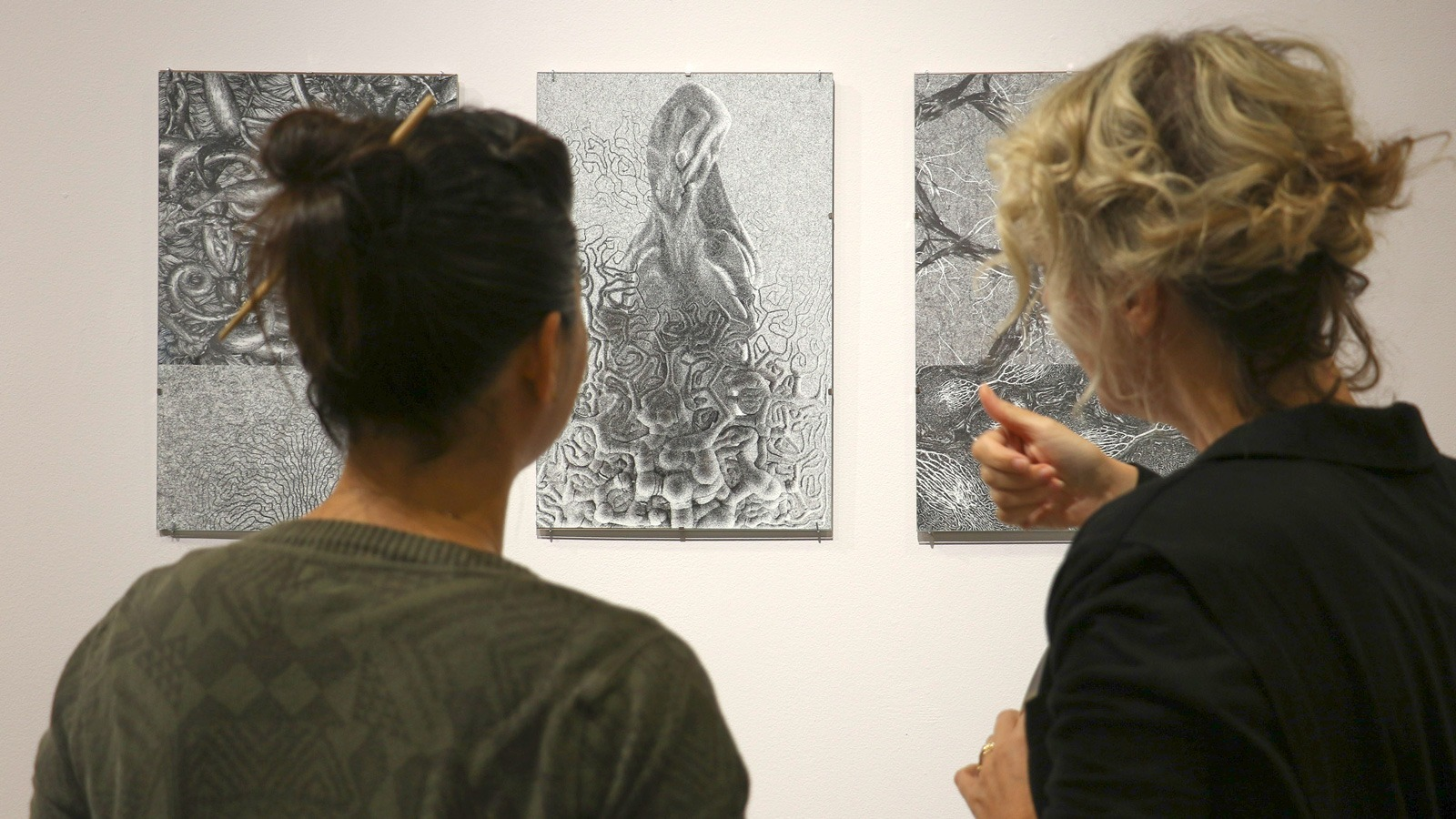 Irma Carrillo/Courier PCC students getting a grasp on the artwork presented in the Boone Gallery during the opening day of the Faculty Exhibition on Thursday Sept. 22.