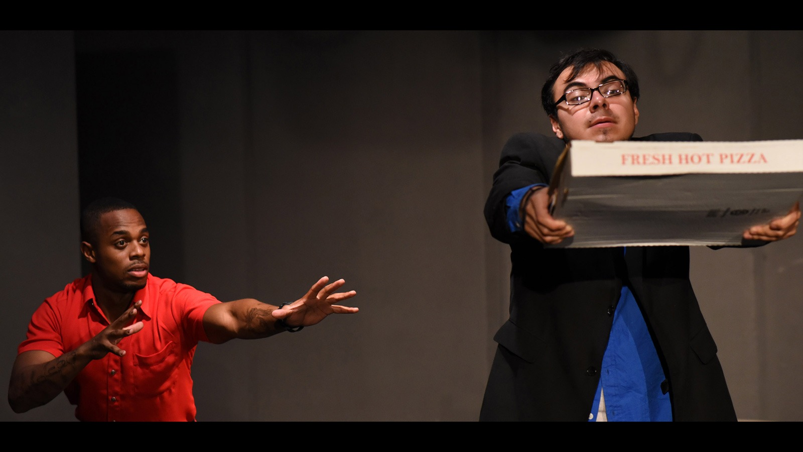"Erick Lemus/Courier Joseph Sepulveda and Yuchao Mi performing in ""Naked Lunch"" from the series of one-act productions ""Trepidation Nation: A Phobic Anthology"" on Oct. 18."
