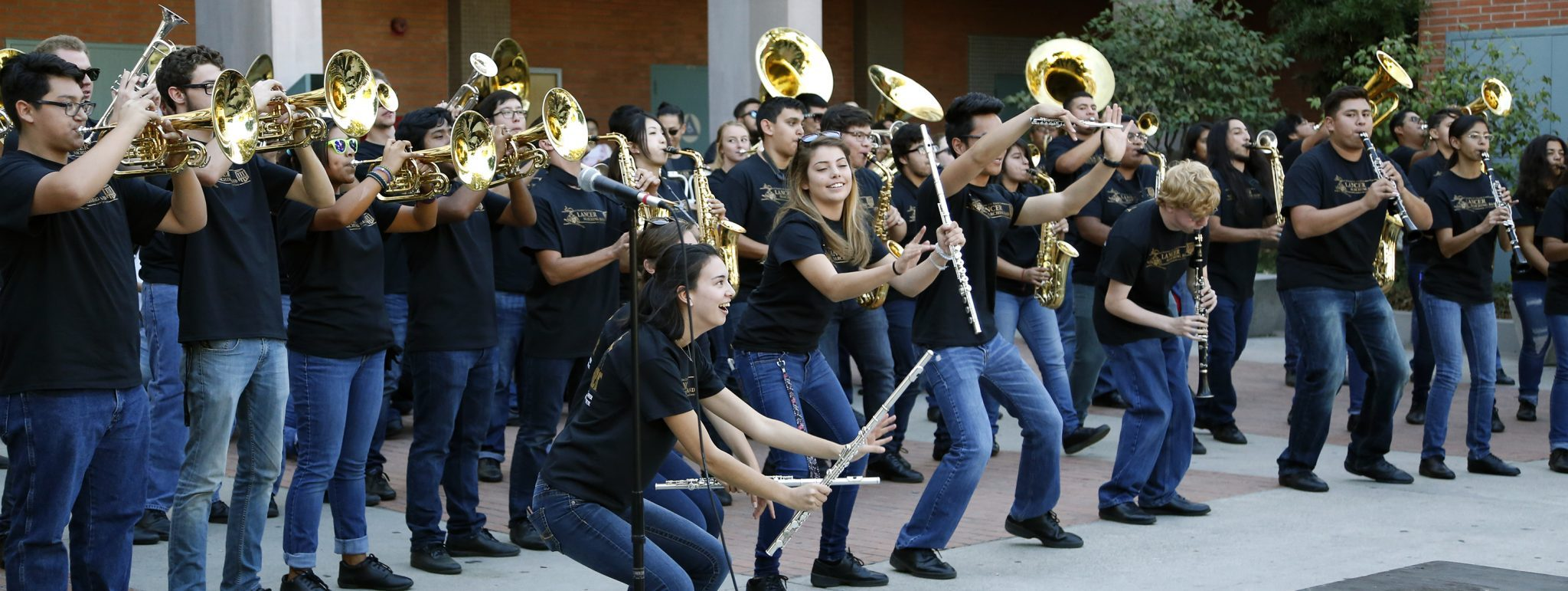 """Kathryn Zamudio/Courier - Soloist Bobby """"Speak Softly, Love"""" from """"The Godfather"""" in Italian and English during the Homecoming Pep Rally outside of the Catherine J. Robbins Building at PCC on Thursday, Nov. 10."""