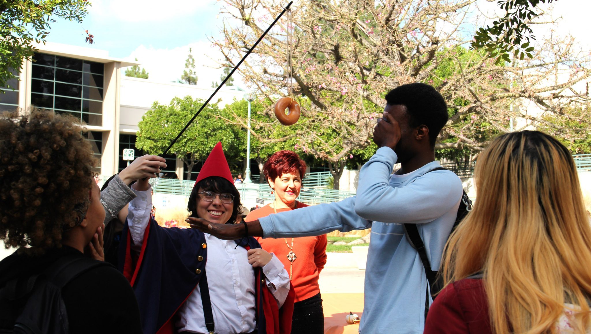 Kait Davie/Courier Ernesto Serrano successfully grabs an apple while bobbing for apples at the Art-O-Ween Fall Festival at PCC.